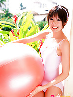 Akina Minami Asian in colorful bath suits plays with big ball