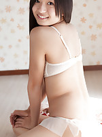 Mayumi Yamanaka Asian smiles while undressing with erotic moves